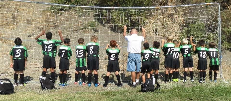 boys soccer rear facing net pose